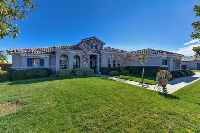 10058 Van Ruiten Lane, Elk Grove, CA 95624 (MLS #221007679) :: The Merlino Home Team