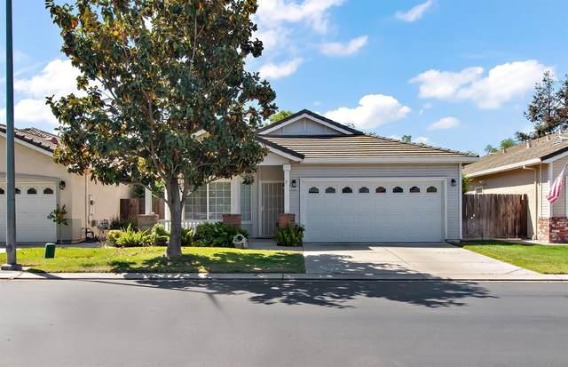 2122 Spring Blossom Lane, Turlock, CA 95382 (MLS #221052621) :: CARLILE Realty & Lending