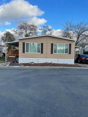 7440 Sylmar Lane, Sacramento, CA 95842 (MLS #221010914) :: Live Play Real Estate | Sacramento