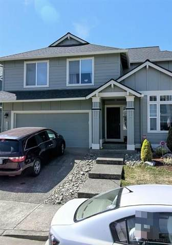 13827 SW 162nd Terrace, Tigard, OR 97223 (MLS #775622) :: Kish Realty Group