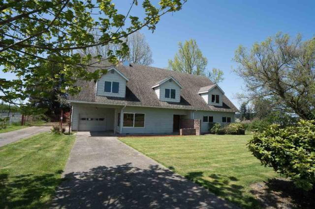 7925 72nd Av NE, Salem, OR 97305 (MLS #732381) :: Song Real Estate