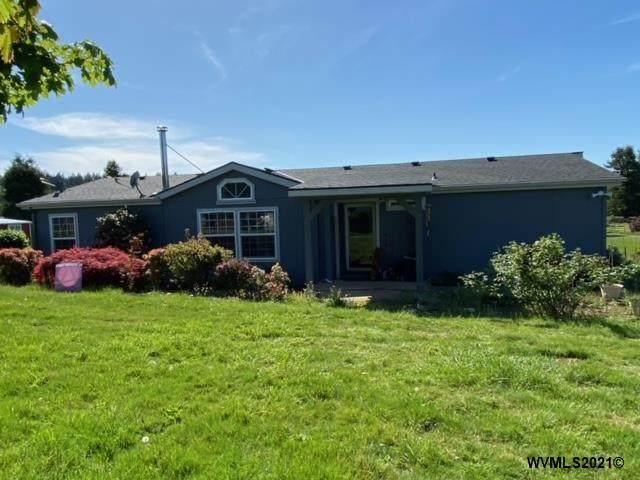 1317 Saunders Ln SE, Salem, OR 97306 (MLS #777095) :: Song Real Estate