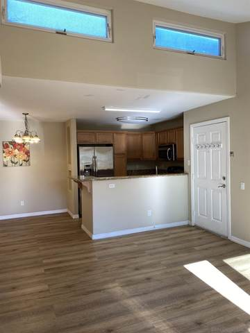 5252 Balboa Arms Dr #203, San Diego, CA 92117 (#210001379) :: PURE Real Estate Group