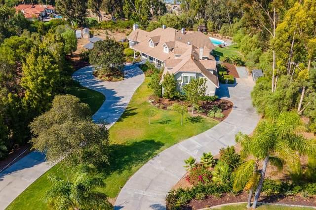 7012 Rancho La Cima Drive, Rancho Santa Fe, CA 92067 (#210010914) :: The Legacy Real Estate Team