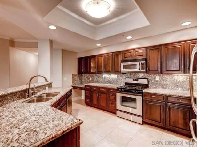 12374 Carmel Country Rd H-110, San Diego, CA 92130 (#210017036) :: Neuman & Neuman Real Estate Inc.