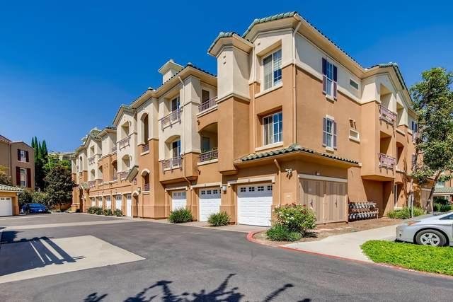 12362 Carmel Country Rd #308, San Diego, CA 92130 (#200046003) :: Tony J. Molina Real Estate