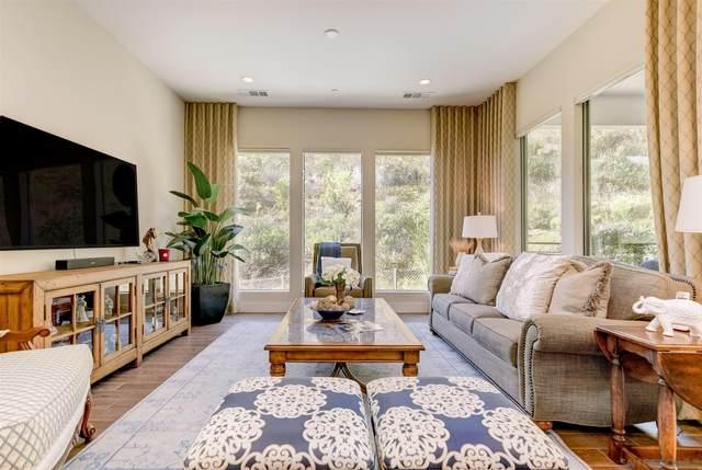 8436 Distinctive Dr, San Diego, CA 92108 (#210009391) :: Neuman & Neuman Real Estate Inc.