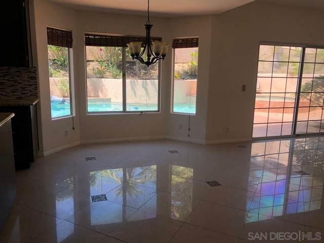 7009 El Fuerte St, Carlsbad, CA 92009 (#200021087) :: Neuman & Neuman Real Estate Inc.