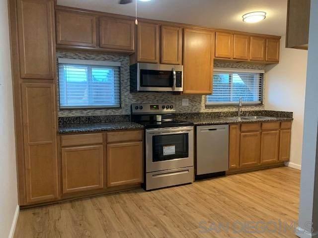 6555 Mount Ada Road #119, San Diego, CA 92111 (#210000568) :: Neuman & Neuman Real Estate Inc.