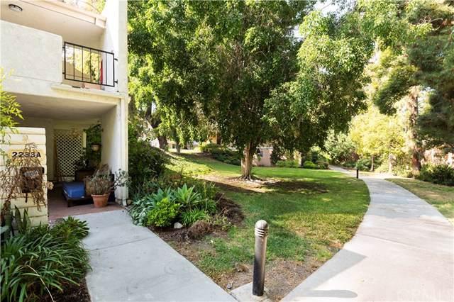 2233 Via Puerta A, Laguna Woods, CA 92637 (#301800511) :: Whissel Realty