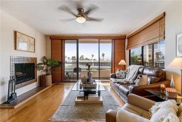 110 The Village #204, Redondo Beach, CA 90277 (#302306950) :: Whissel Realty