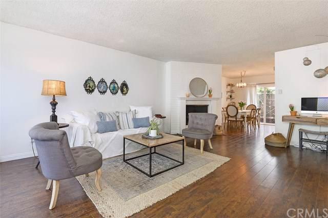 13902 Yorba Street 9B, Tustin, CA 92780 (#302409227) :: Pugh-Thompson & Associates