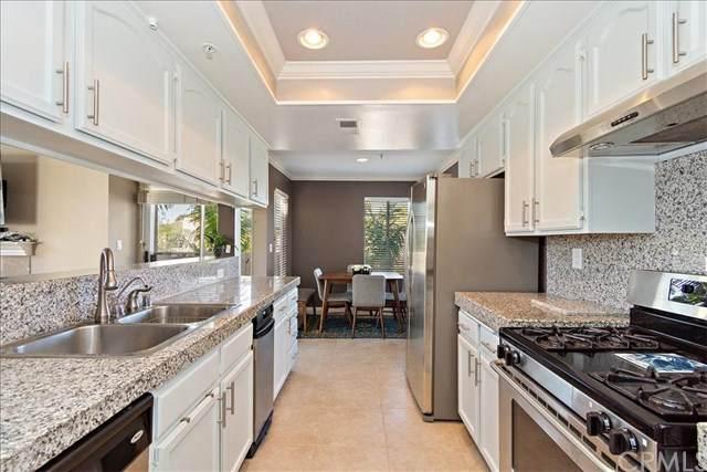 4571 Warner Avenue #306, Huntington Beach, CA 92649 (#302435787) :: Keller Williams - Triolo Realty Group