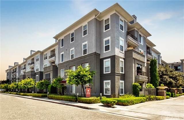 1801 E Katella Avenue #3127, Anaheim, CA 92805 (#302618245) :: Whissel Realty