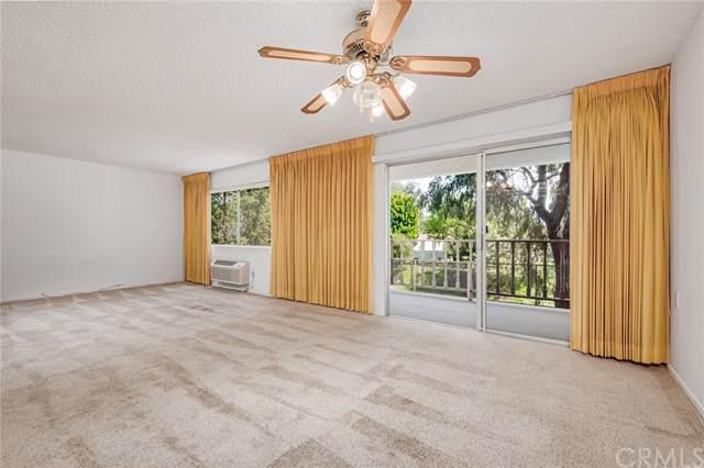 3500 Bahia Blanca W 2B, Laguna Woods, CA 92637 (#OC21068609) :: Wannebo Real Estate Group