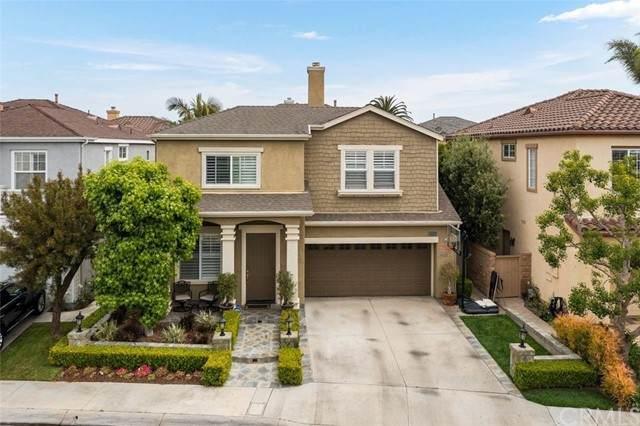 16812 Pembrook Lane, Huntington Beach, CA 92649 (#OC21105778) :: Keller Williams - Triolo Realty Group