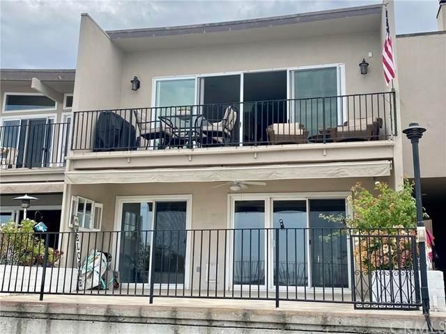 15982 Mariner Drive #18, Huntington Beach, CA 92649 (#PW21178703) :: COMPASS