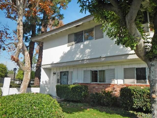14802 Newport Avenue 8A, Tustin, CA 92780 (#302404380) :: Pugh-Thompson & Associates