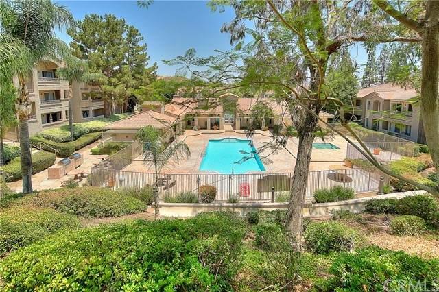1980 Las Colinas Circle #307, Corona, CA 92879 (#IG21211658) :: Wannebo Real Estate Group