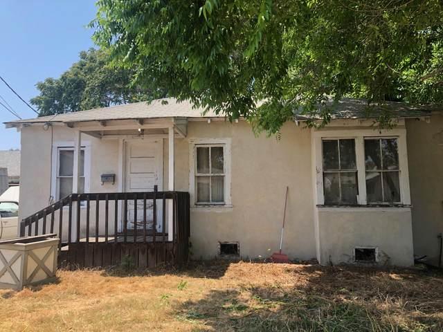 1051 Holly, Carpinteria, CA 93013 (MLS #21-2314) :: Chris Gregoire & Chad Beuoy Real Estate