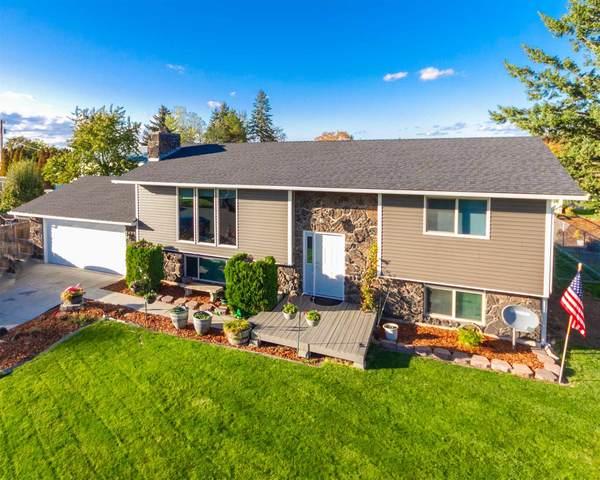 15115 E 11th Ave, Spokane Valley, WA 99037 (#202123543) :: The Hardie Group