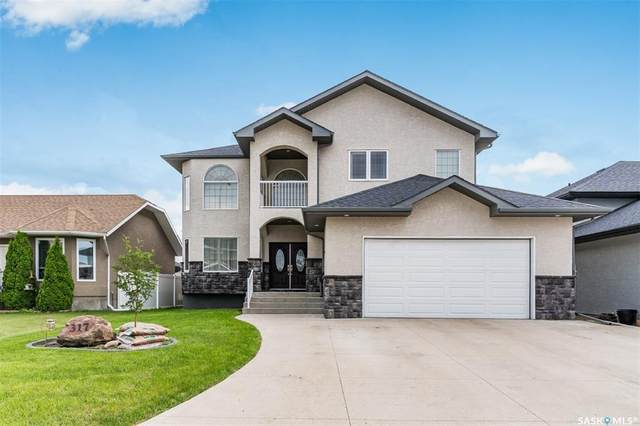 317 Nicklaus Drive, Warman, SK S0K 4S0 (MLS #SK815764) :: The A Team