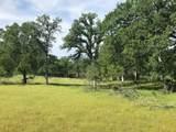Whispering Oaks - Photo 1