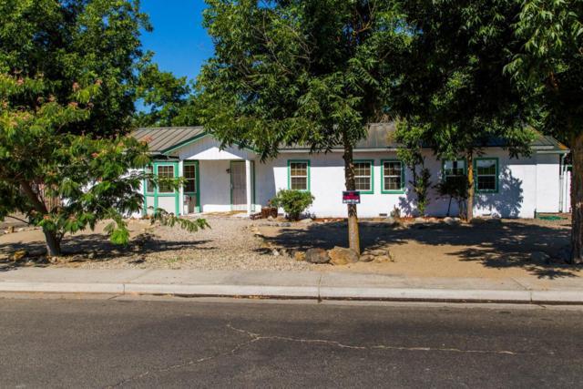 1218 N Lynn Ave, Dos Palos, CA 93620 (#ML81721180) :: The Kulda Real Estate Group