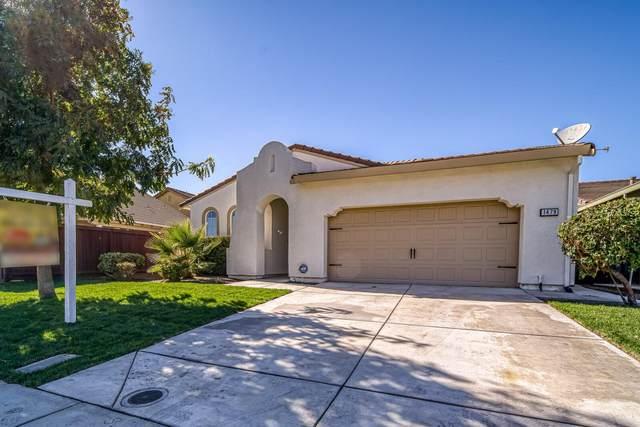 1479 Orgullo Ln, Manteca, CA 95337 (#ML81866708) :: The Sean Cooper Real Estate Group