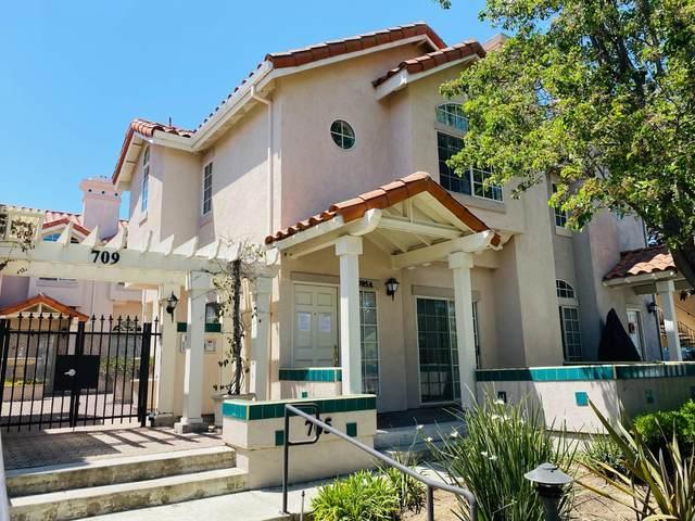 705 Woodside Way A, San Mateo, CA 94401 (#ML81842054) :: The Goss Real Estate Group, Keller Williams Bay Area Estates