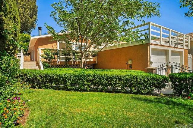25132 Vermont Drive, Newhall, CA 91321 (#SR21122121) :: The Kohler Group
