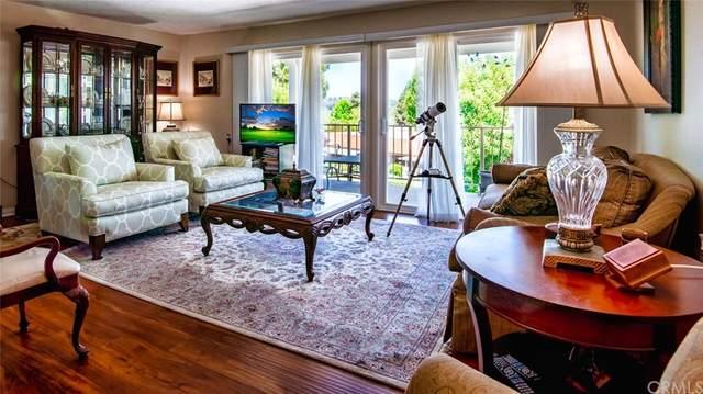 827 Via Alhambra O, Laguna Woods, CA 92637 (#OC21145483) :: Mark Nazzal Real Estate Group