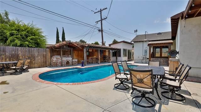 10848 Juniper Street, Los Angeles (City), CA 90059 (#IV21158122) :: Robyn Icenhower & Associates