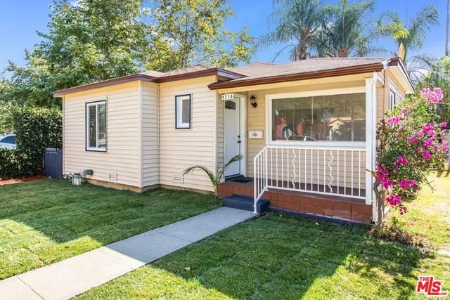 5718 Linden Avenue, Long Beach, CA 90805 (#21764176) :: Robyn Icenhower & Associates