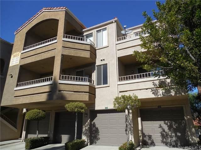 1035 La Terraza Circle #208, Corona, CA 92879 (#CV21161790) :: The Kohler Group