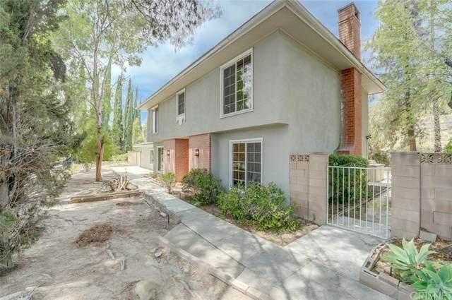 8701 Topanga Canyon Boulevard, West Hills, CA 91304 (#SR21160151) :: RE/MAX Masters