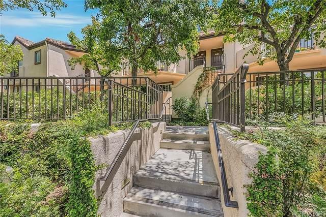 24105 Del Monte Drive #445, Valencia, CA 91355 (#SR21157037) :: Realty ONE Group Empire
