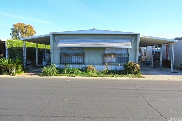 14092 Browning Ave. #59, Tustin, CA 92780 (#OC21168166) :: Latrice Deluna Homes