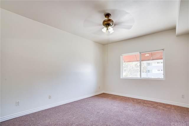 9610 Zelzah Ave #111, Northridge, CA 91325 (#SR21168116) :: Better Living SoCal