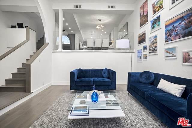 18701 Hatteras Street #4, Tarzana, CA 91356 (#21767384) :: Doherty Real Estate Group