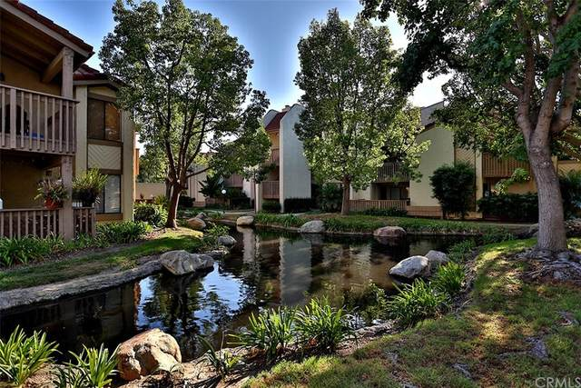 4831 Lago Drive #101, Huntington Beach, CA 92649 (#OC21168884) :: Cochren Realty Team   KW the Lakes