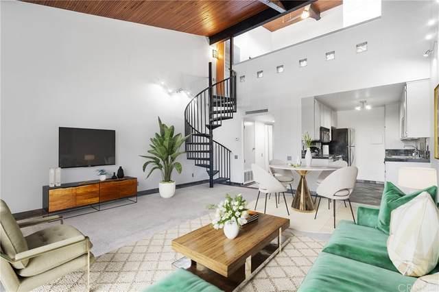 5460 White Oak Avenue B301, Encino, CA 91316 (#SR21165791) :: Doherty Real Estate Group