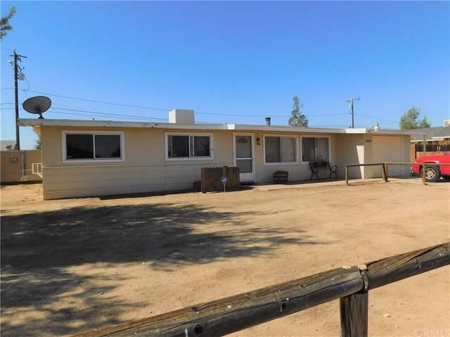 8836 Catalpa Avenue, California City, CA 93505 (#CV21171538) :: Doherty Real Estate Group