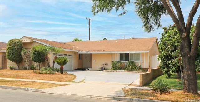 14101 Woodlawn Avenue, Tustin, CA 92780 (#OC21179829) :: Robyn Icenhower & Associates