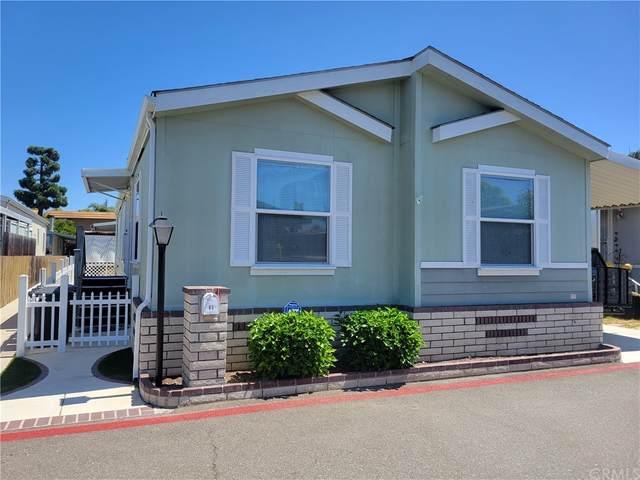 6301 Warner #65, Huntington Beach, CA 92647 (#OC21197193) :: Steele Canyon Realty