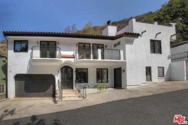 9845 Portola Drive, Beverly Hills, CA 90210 (#21779552) :: The Miller Group