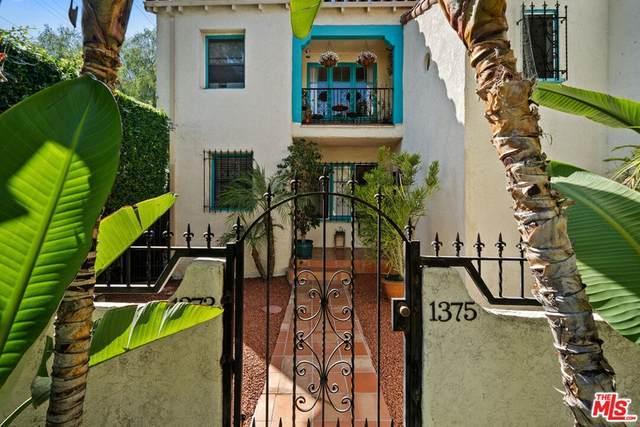 1373 S Ridgeley Drive, Los Angeles (City), CA 90019 (#21783312) :: Steele Canyon Realty