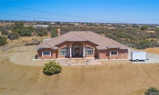 7760 Barker Road, Oak Hills, CA 92344 (#CV21205542) :: Zember Realty Group