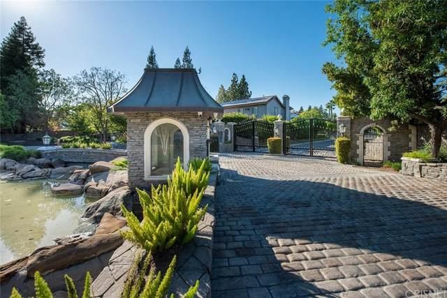 7536 N Highgrove Lane, Fresno, CA 93711 (#SR21205657) :: RE/MAX Empire Properties