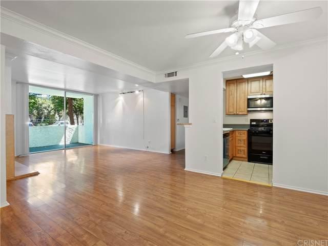 5325 Newcastle Avenue #106, Encino, CA 91316 (#SR21206111) :: Corcoran Global Living